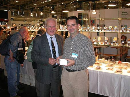 Jordi Fabre in front of his stand at the Munich 2002 show, along with Professor Curzio Cipriani