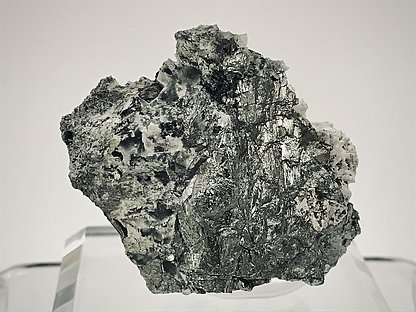 Löllingite with Diopsido and chrysotile.