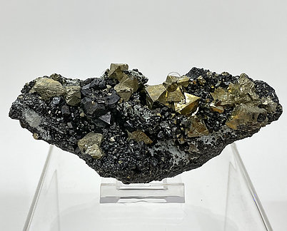 Octahedral Pyrite with Magnetite and Calcite.