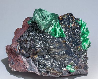 Malachite after Azurite on Goethite.