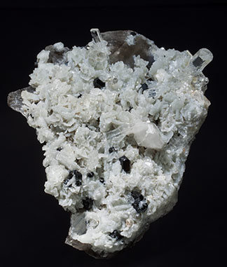 Twinned Phenakite with Albite, Schorl and Quartz (variety smoky).
