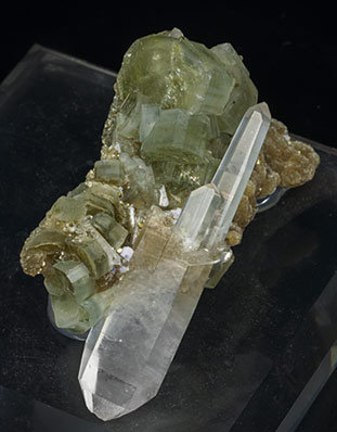 Fluorapatite with Quartz, Arsenopyrite and Muscovite.