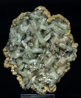 Fluorapatite with Pyrite, Siderite and Muscovite.