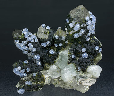 Fluorite with Topaz, Quartz, Arsenopyrite and Muscovite.