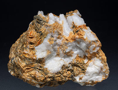 Tinzenite with Quartz.