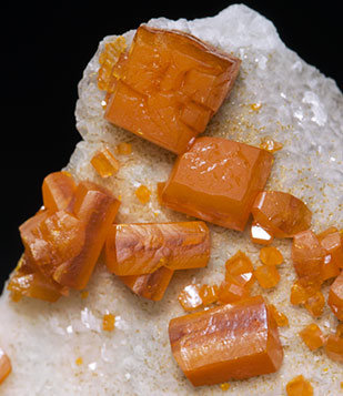 Wulfenite on Calcite.
