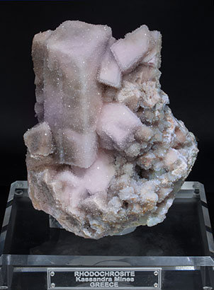 Rhodochrosite with Quartz and Pyrite. Fluorescent light (day light)