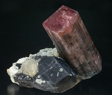 Tourmaline with Quartz (variety smoky), Mica and Feldspar.