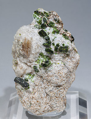 Mn-rich Andalusite (variety viridine) with Quartz and Mica.