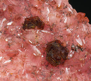 Shigaite on Rhodochrosite.