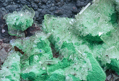 Malachite after Azurite with Baryte and Goethite.