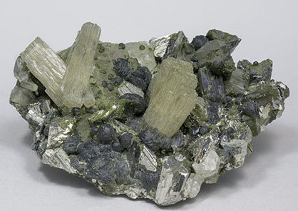Fluorapatite with Arsenopyrite, Chlorite and Quartz.