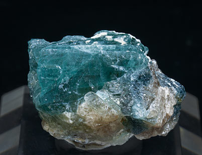Grandidierite with Quartz, Feldspar and Diopside.