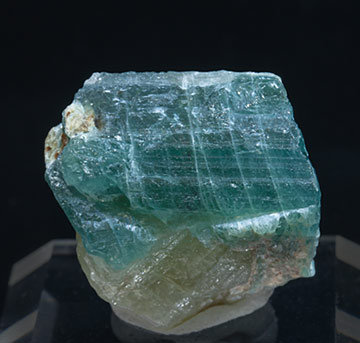Grandidierite with Quartz, Feldspar, Diopside and Mica.