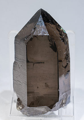 Quartz (variety smoky) with Hematite inclusions.