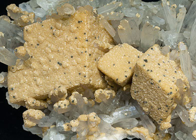 Calcite with ferroan Dolomite, Quartz and Pyrite.