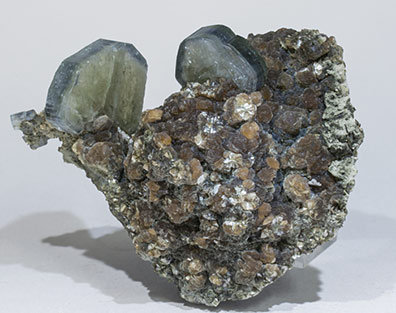 Fluorapatite with Quartz, Muscovite and Siderite.