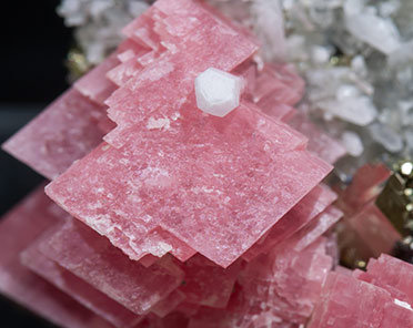 Rhodochrosite with Quartz, Sphalerite and Pyrite.
