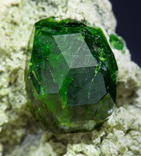 Andradite (variety demantoid) with Diopside.