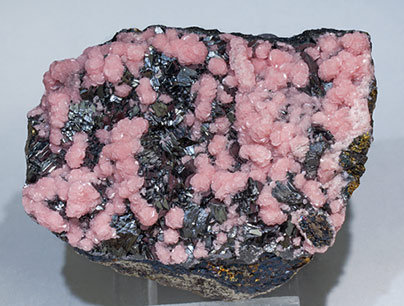 Rhodochrosite with Tennantite-Tetrahedrite (Series).