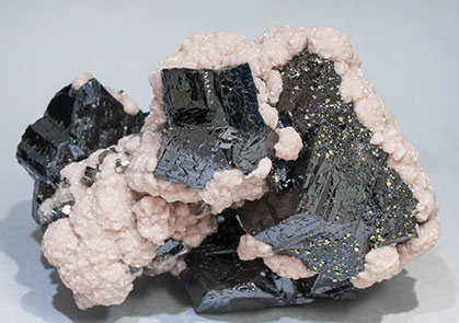 Sphalerite with Rhodochrosite, Pyrite, Galena and Arsenopyrite.