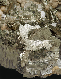 Arsenopyrite - Marcasite with Siderite and Muscovite.