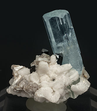 Beryl (variety aquamarine) with Feldspar, Mica and Schorl. Rear
