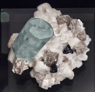 Beryl (variety aquamarine) with Feldspar, Mica and Schorl. Top