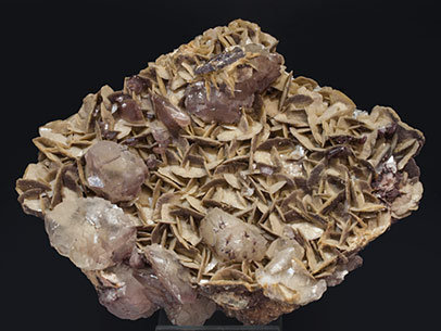 Calcite with Siderite, Dolomite and Hematite.
