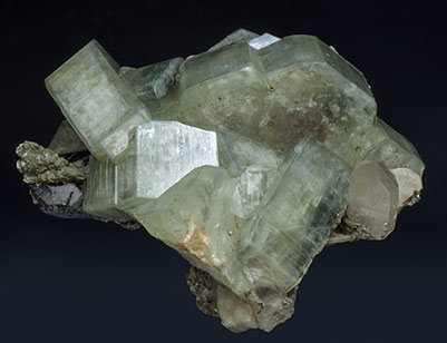 Fluorapatite with Ferberite, Siderite, Quartz and Muscovite.
