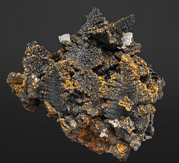 Willemite after Descloizite with Mimetite and Calcite.