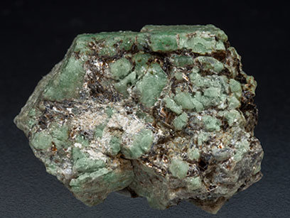 Beryl (variety emerald) with Phlogopite. Rear