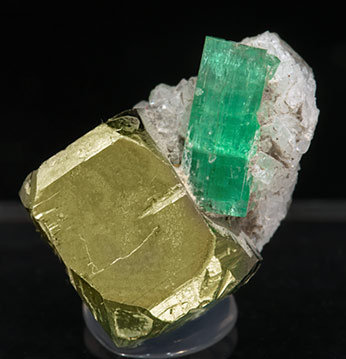 Beryl (variety emerald) with Pyrite and Calcite.