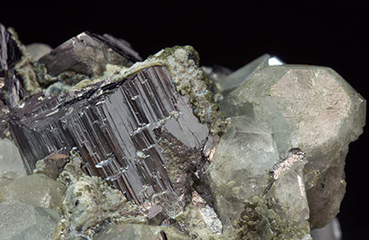 Topaz with Arsenopyrite, Muscovite and Chlorite.