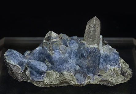 Fluorite on Topaz and Arsenopyrite with Quartz . Rear