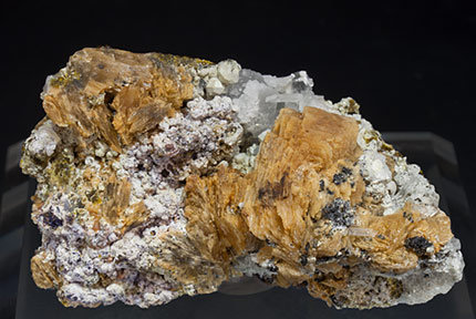 Roweite with Olshanskyite, Andradite and Calcite.