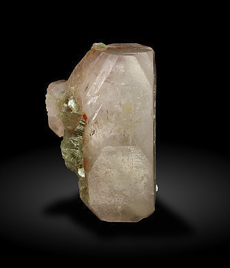 Beryl (variety morganite) with Muscovite. Side