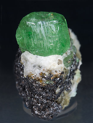 Grossular (variety tsavorite) with Pyrite and Graphite. Front