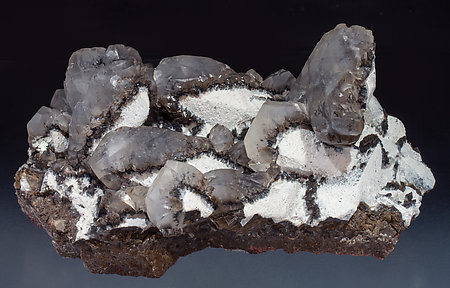 Twinned Calcite with Calcite, Palygorskite and manganese oxides. Front