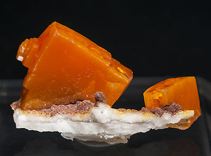 Wulfenite with As rich Vanadinite and Calcite. Rear