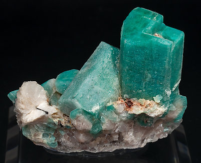 Microcline (variety amazonite) with Albite and Schorl.