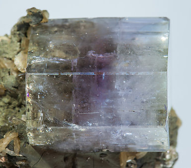 Fluorapatite with Siderite, Muscovite and Chlorite.