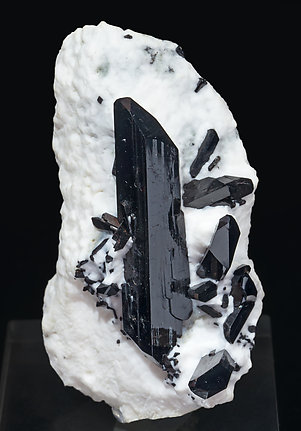 Neptunite on Natrolite.