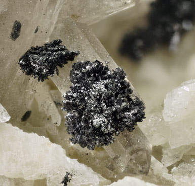 Pyrophanite with Feldspar and Quartz (variety smoky).