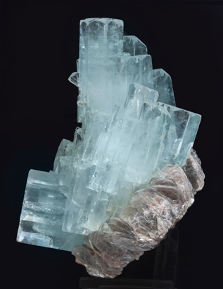 Beryl (variety aquamarine) with Muscovite. Side