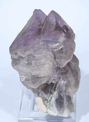 Quartz (variety amethyst) with Quartz (variety smoky) and Microcline. Rear