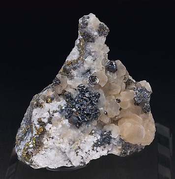 Pearceite-T2ac with Calcite, Pyrite and Chalcopyrite.