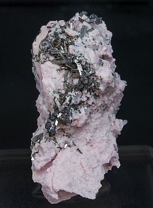 Rhodochrosite with Arsenopyrite.