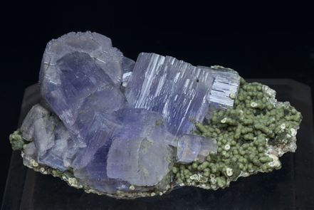 Fluorapatite with Muscovite and Chlorite.