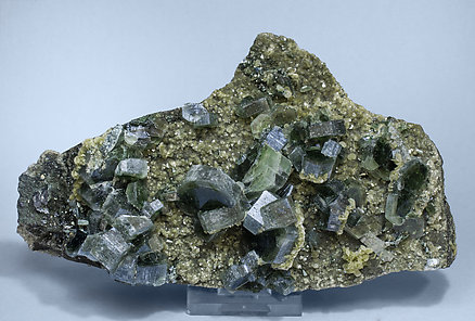 Fluorapatite with Siderite, Muscovite, Marcasite and Arsenopyrite.